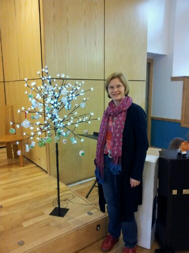 Shona Adam standing in front of our Christmas card tree