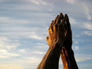 Photo of a statue of praying hands at Oral Roberts University, Tulsa.