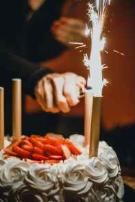 person lighting the sparklers